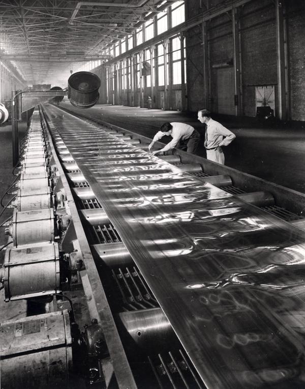 men in a metal processing plant