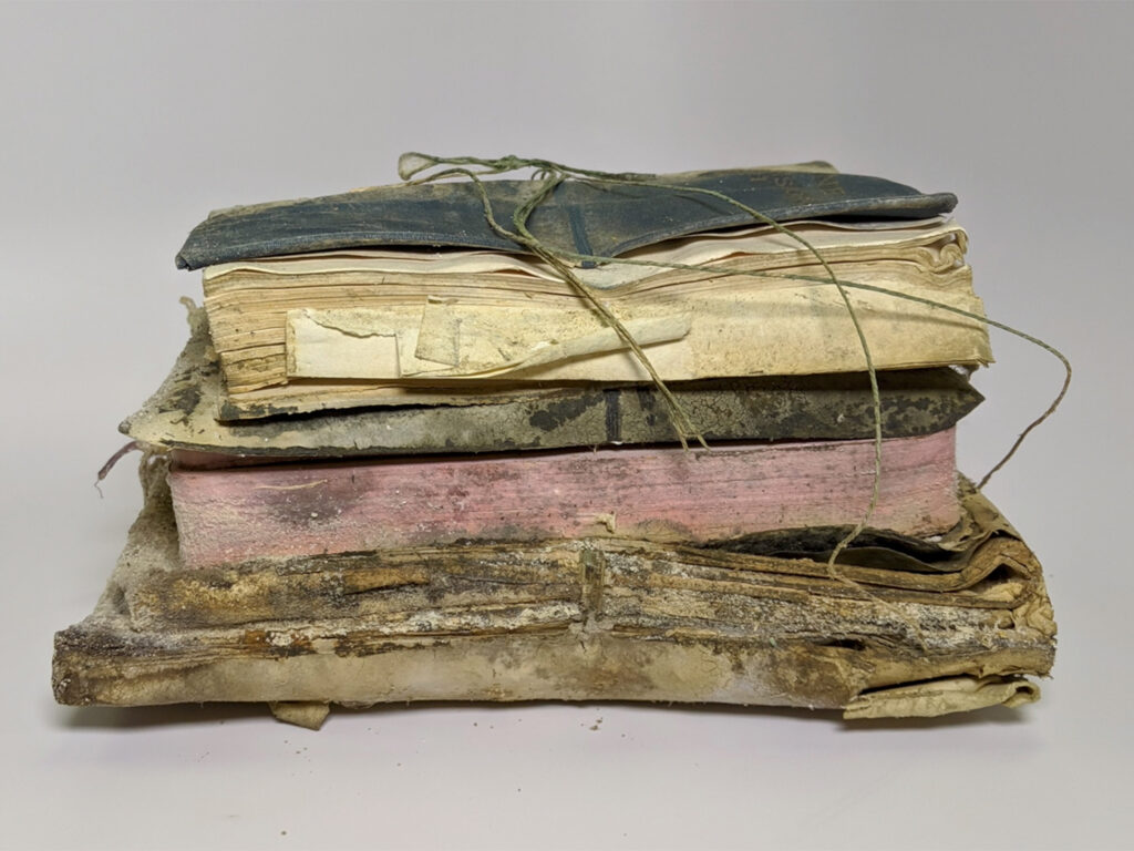Box Contents: Holy Bible, Map of Eastern Africa: Folded, and Collections of unidentifiable papers: Stuck together