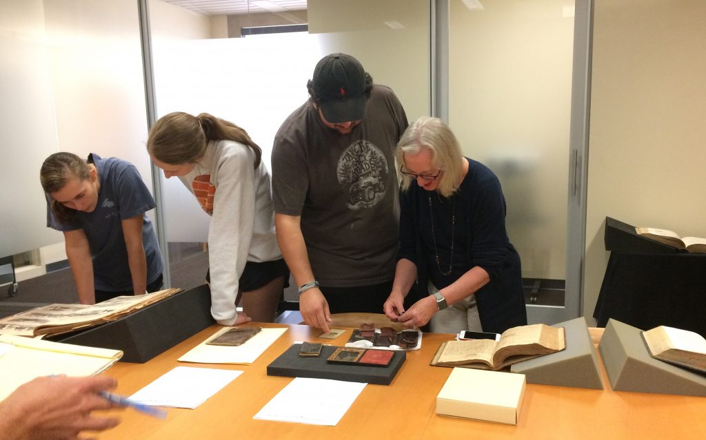 Professor Lawrence works with students from the Civil War Medicine class.